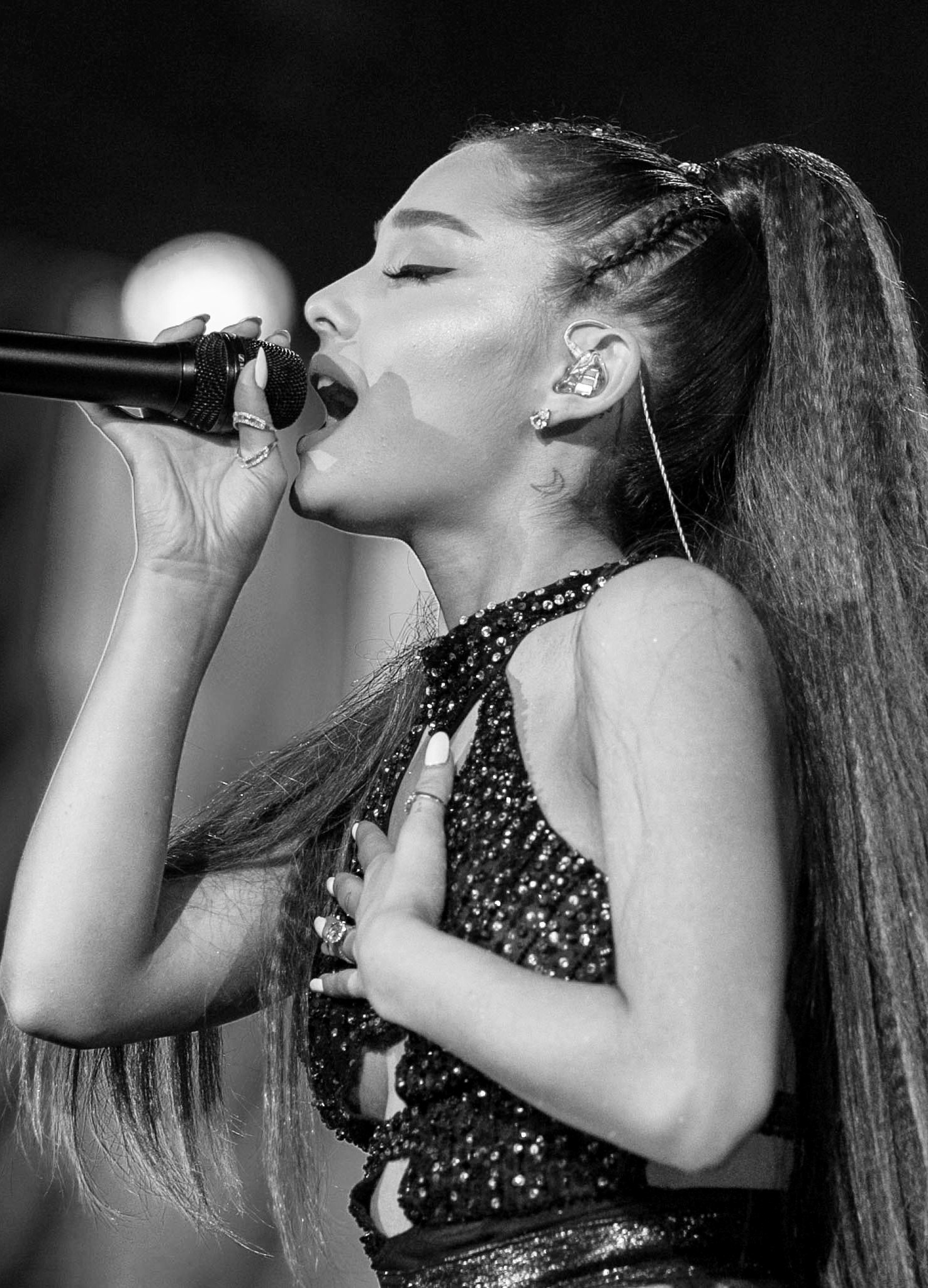 LOS ANGELES, CA - JUNE 02:  (Editors note: Image has been conveted to black and white.) (EDITORIAL USE ONLY. NO COMMERCIAL USE) Ariana Grande performs onstage during the 2018 iHeartRadio Wango Tango by AT&T at Banc of California Stadium on June 2, 2018 in Los Angeles, California.  (Photo by Rich Polk/Getty Images for iHeartMedia )